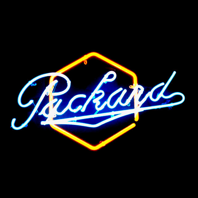 resized Packard script over yellow hexagon.jpg