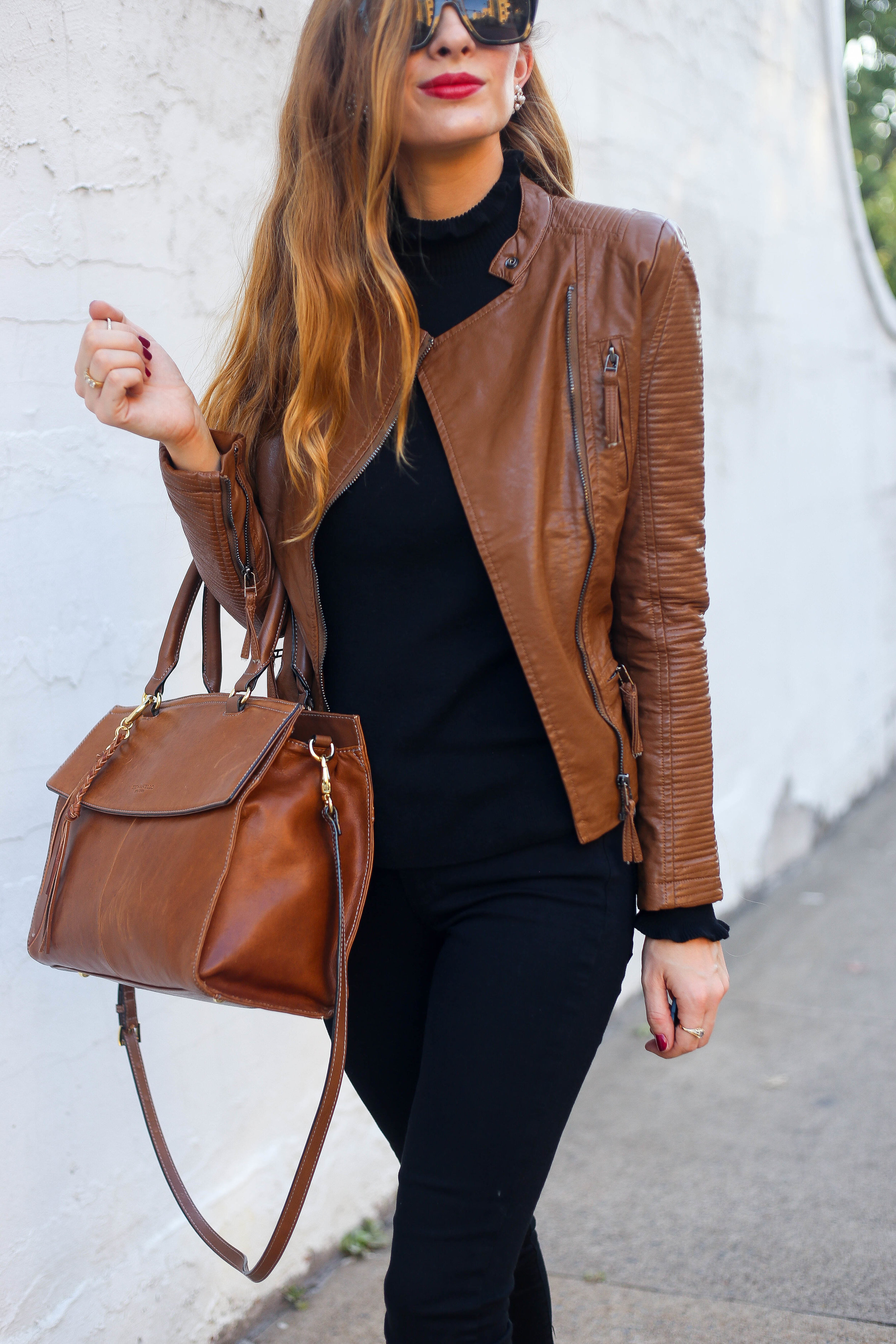 Tan Leather Jacket. Black Sweater. Black Skinny Jeans.