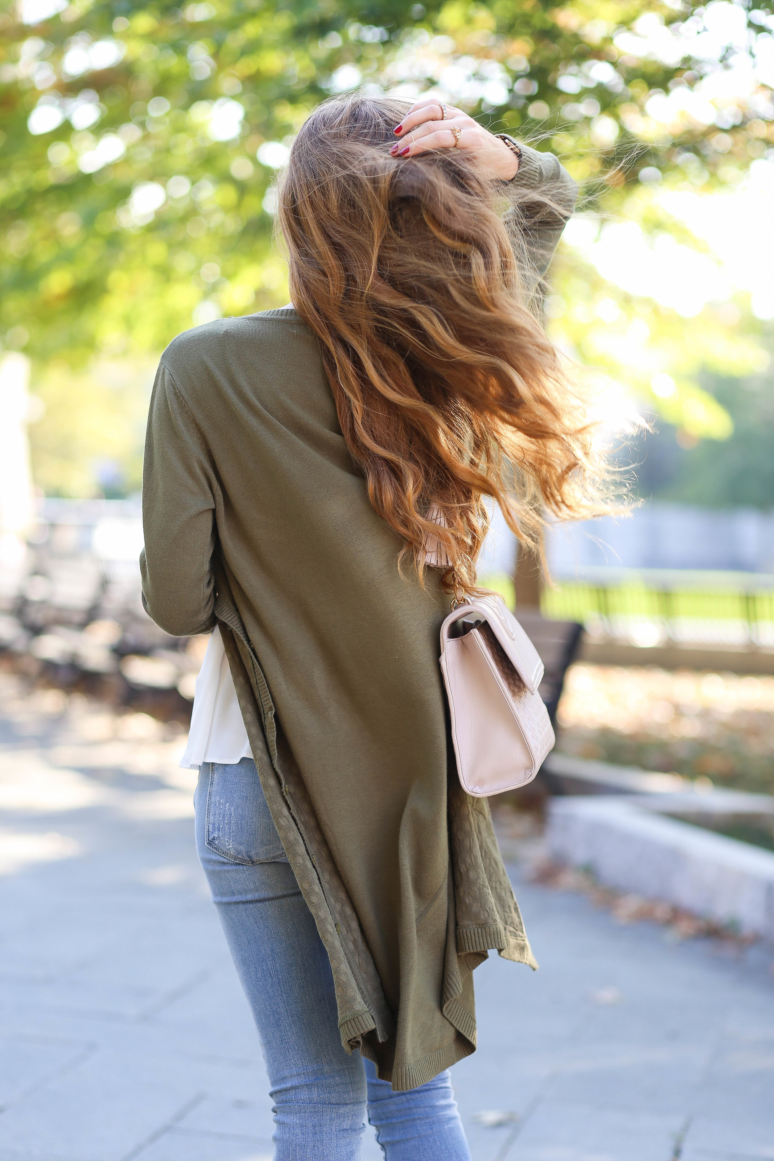 Olive Green Cardigan. White Tank Top. Light Blue Distressed Skinny Jeans. Tory Burch Cream Bag. Tan Booties.