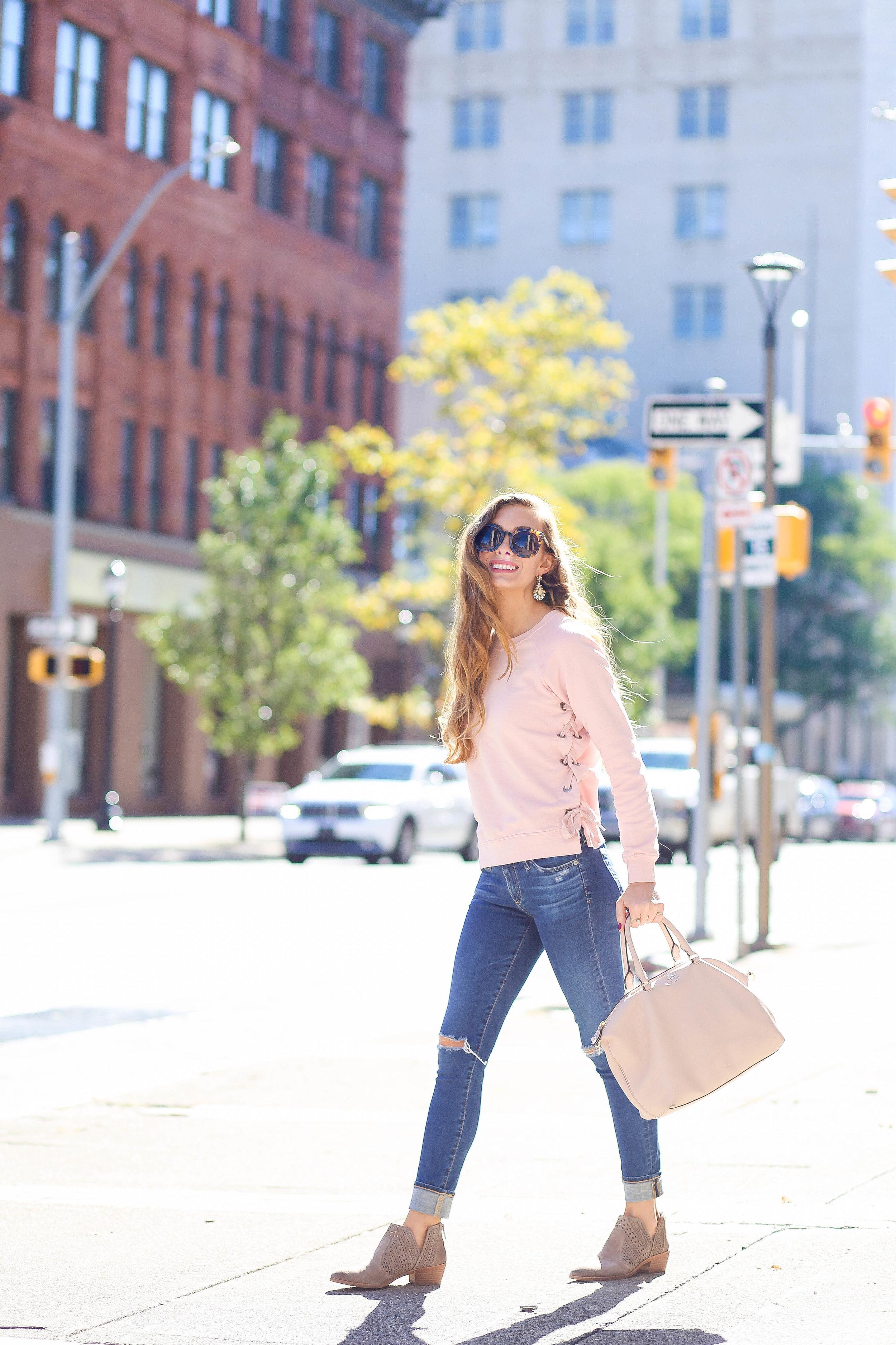 Pink Sweatshirt. Skinny Jeans. Blush Bag. Gray Booties.