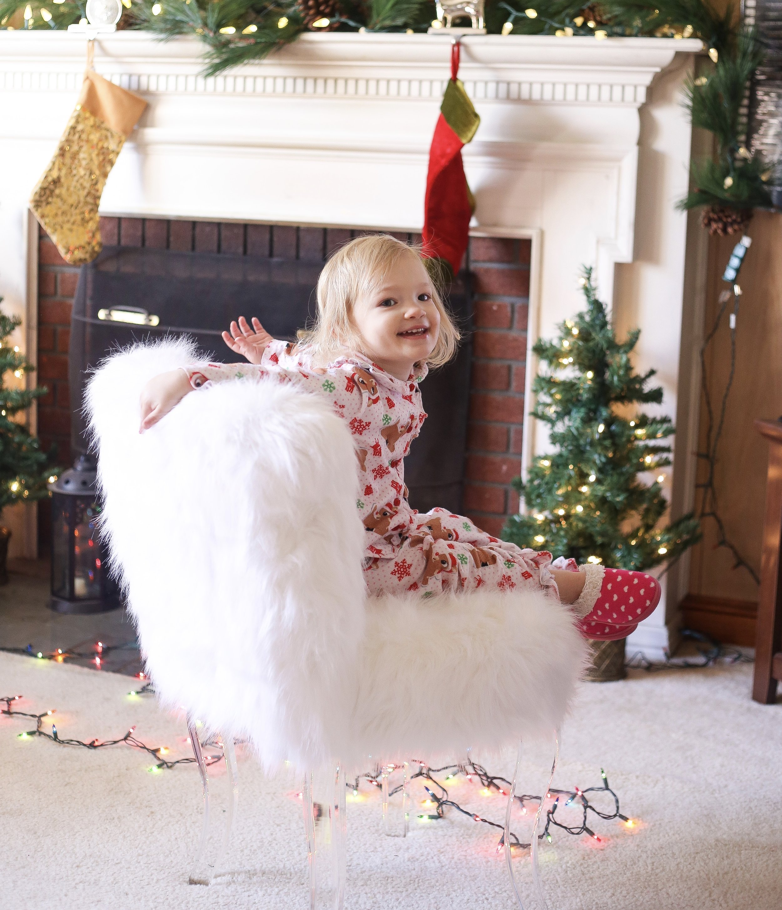 """A snapshot of Ava loving the """"fuzzy""""  chair  we have."""