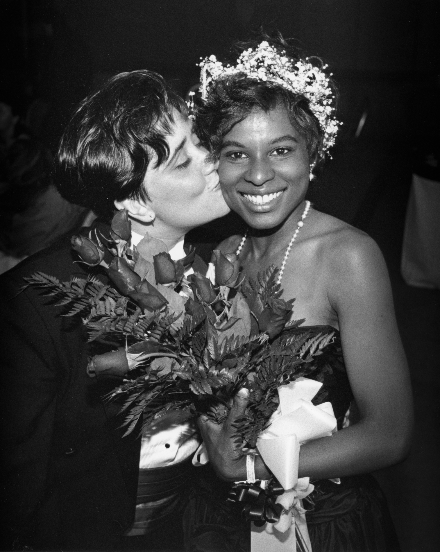 "At the age of 27, Lorelei Holness was named the ""Prom Queen"" at a 1991 alternative prom for adults who never had the opportunity to go to their own high school prom with the true date of their choice."