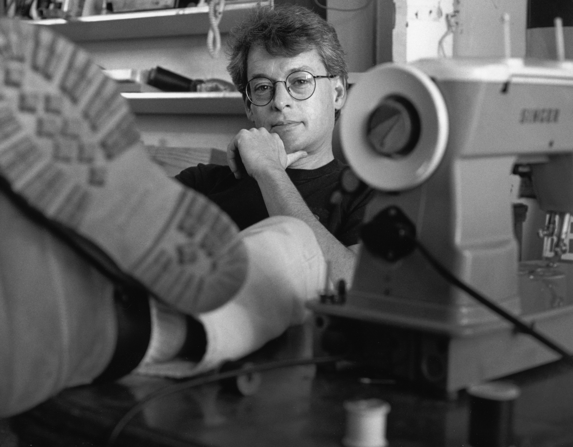 "Cleve Jones changed the way we mourned those we lost from AIDS, changing us all in the process too. He was photographed at the sewing machine at the headquarters for ""The Names Project AIDS Memorial Quilt"" in 1993."