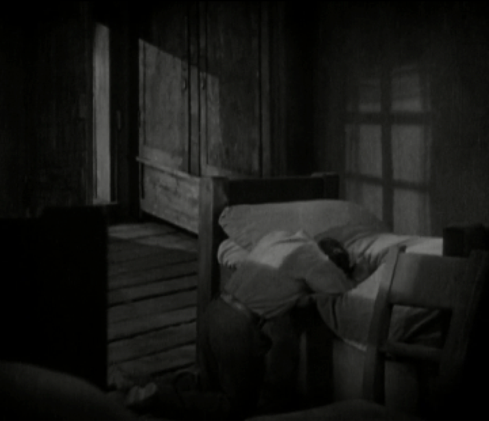Image 4. The man is overcome with grief and falls to his knees by the bed. He leans over the bed, an image of a man trying to hold onto what he thinks he's lost.