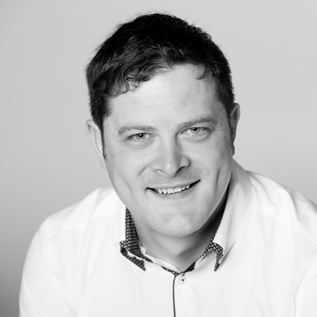 Black and white headshot image of Mark Goodwin