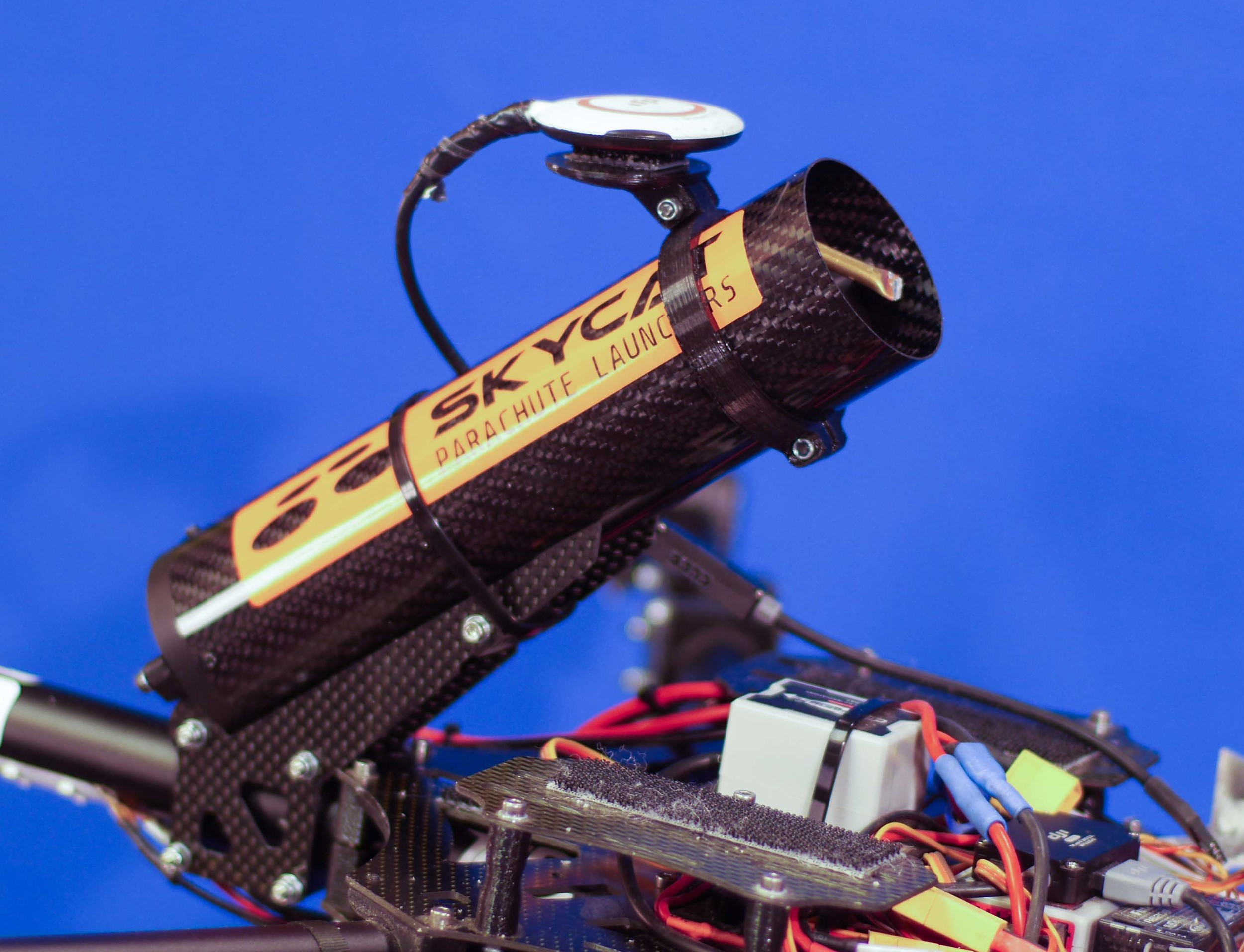 Skycat X55-CF launcher integrated into a quadcopter, also serving as a GPS mount. Customer project.  Universal mount