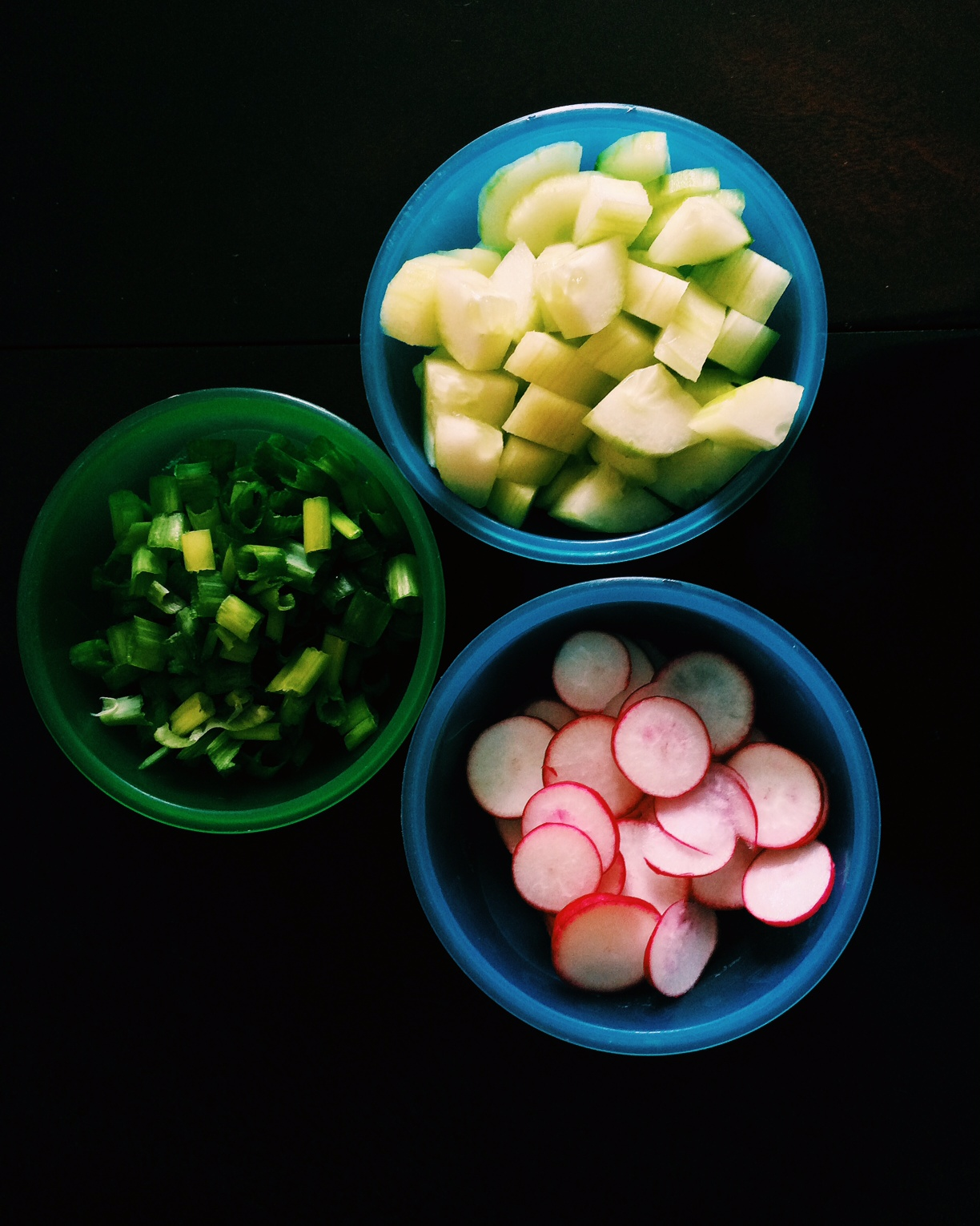 2. Meanwhile chop scallions, radishes, and cucumber.