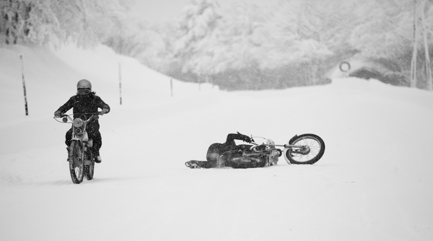 Two guys doing their best to enjoy a snowy ride... Obviously, not that easy...