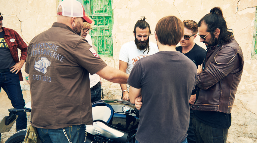 We're all religiously and carefully listening to Ola Stennegard (head of Design atBMw Motorrad)...