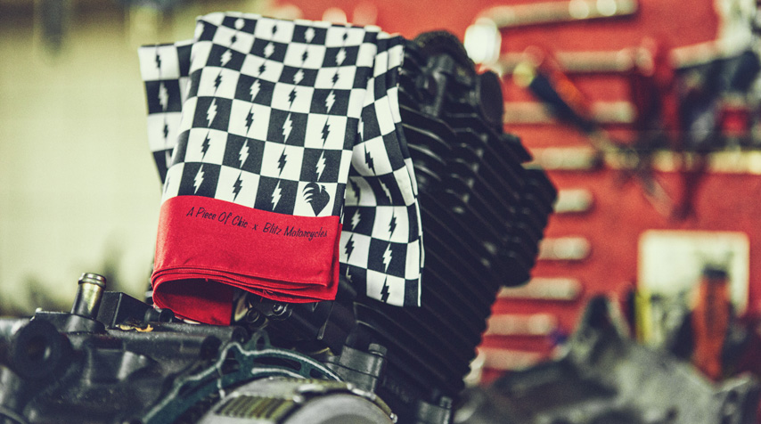 """The """"classic scarf"""" on top of a Suzuki DR 650 engine under customization."""