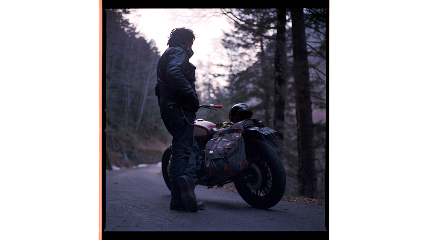"""Perkins and the BMW R100/7 """"Street Tracker"""" in the woods."""