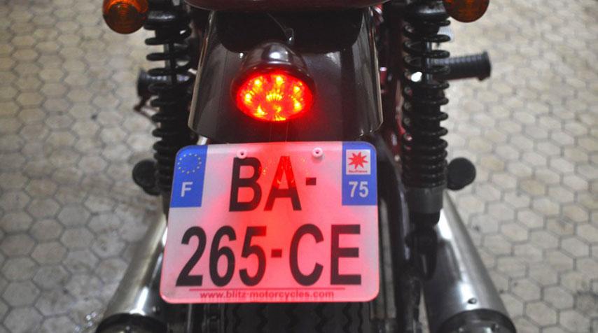 - Handmade rear fender with shiny black powder coated. - Supertrapp Mufflers. - Custom 'mini bates' tail light.