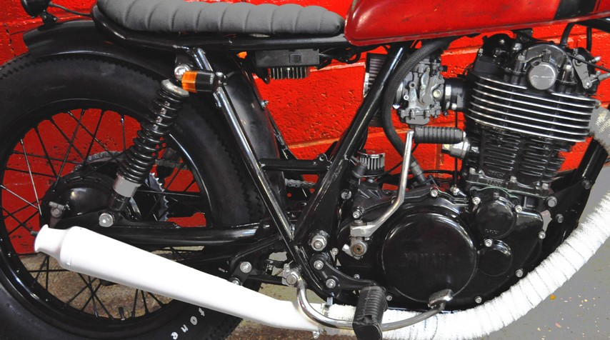 High temperature white painting of the exhaustto match the grips. And why not?