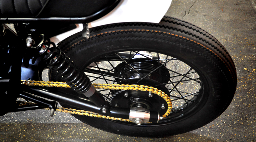 """- New secondary chain kit (gold colour to match the front disc brake); - """"+4 cm"""" swing arm; - no tail light since the rear blinkers include stop + tail light."""