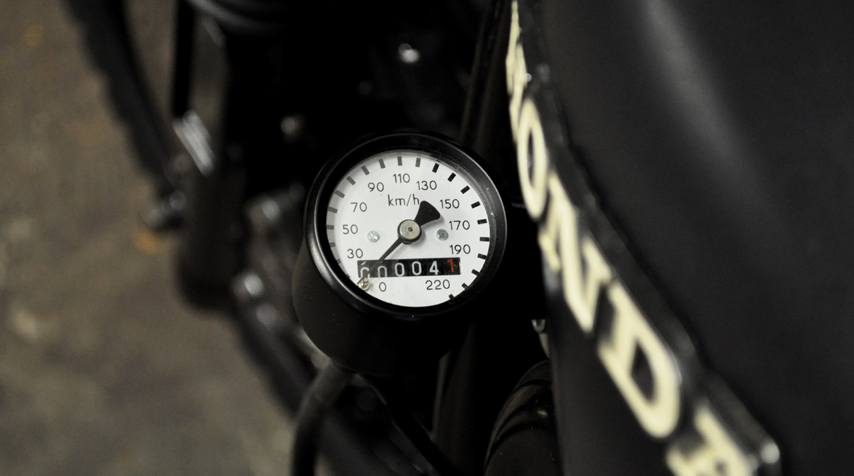 Small speedometer mounted on the left side of the motorcycle.