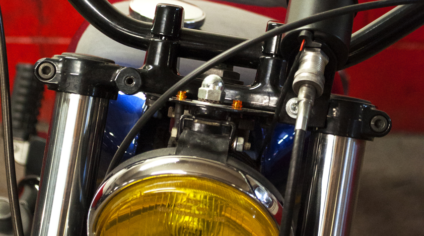 Bespoke bracket to hold the headlight + dashboard lights (neutral and oil pressure).