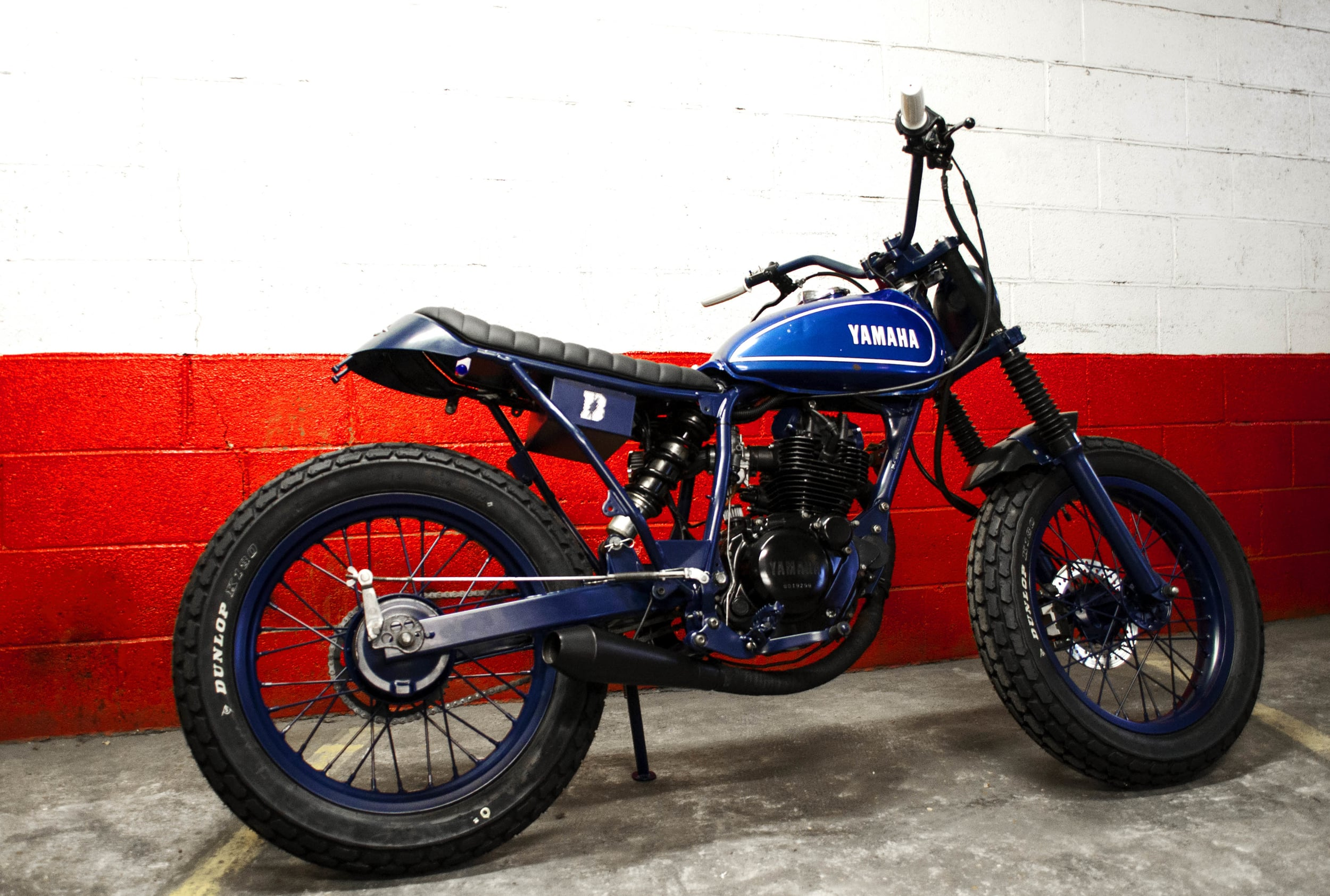 """- 18 inches rear wheel mounted to give a real """"dirt track"""" look to the machine;  - of course,  Dunlop K180  mounted on both front and rear wheels;  - 100 % mat blue powder coating of the whole machine (frame, swing arm, fork legs, headlight, foot rests, side stand, etc...)."""