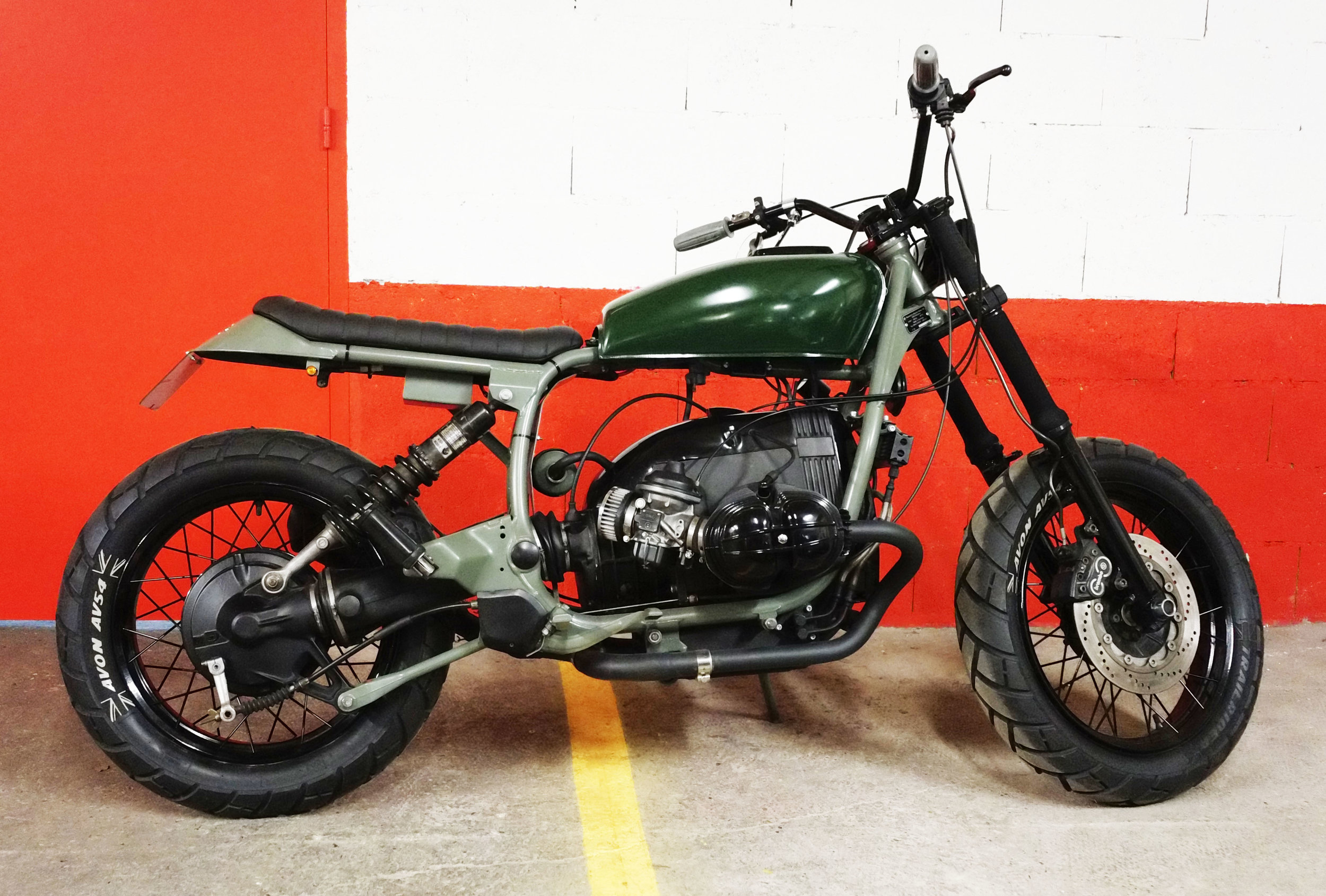 """Vintage  Honda CB 125 SS  tank painted in green to match with the """"military"""" spirit of this bike."""