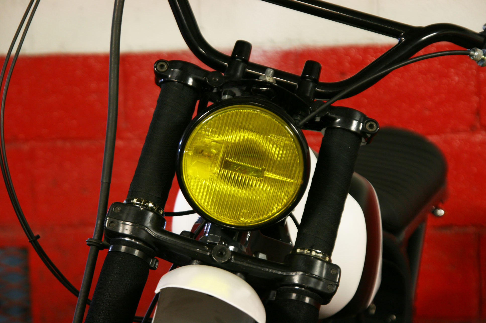 - Vintage headlight from a 70's rally car installed (comes in yellow genuinely);  - motocross type handlebar.
