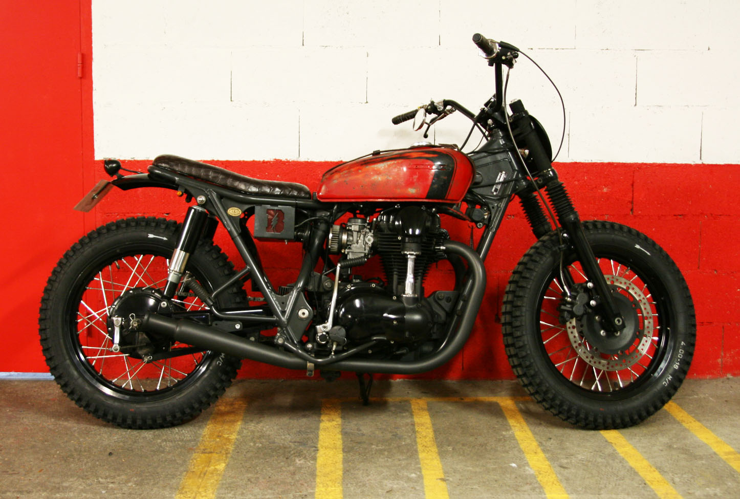 - Fully re-worked  Kawasaki W650 ;  - Frame shortened by 2 inches;  - bespoke battery box welded under the seat.