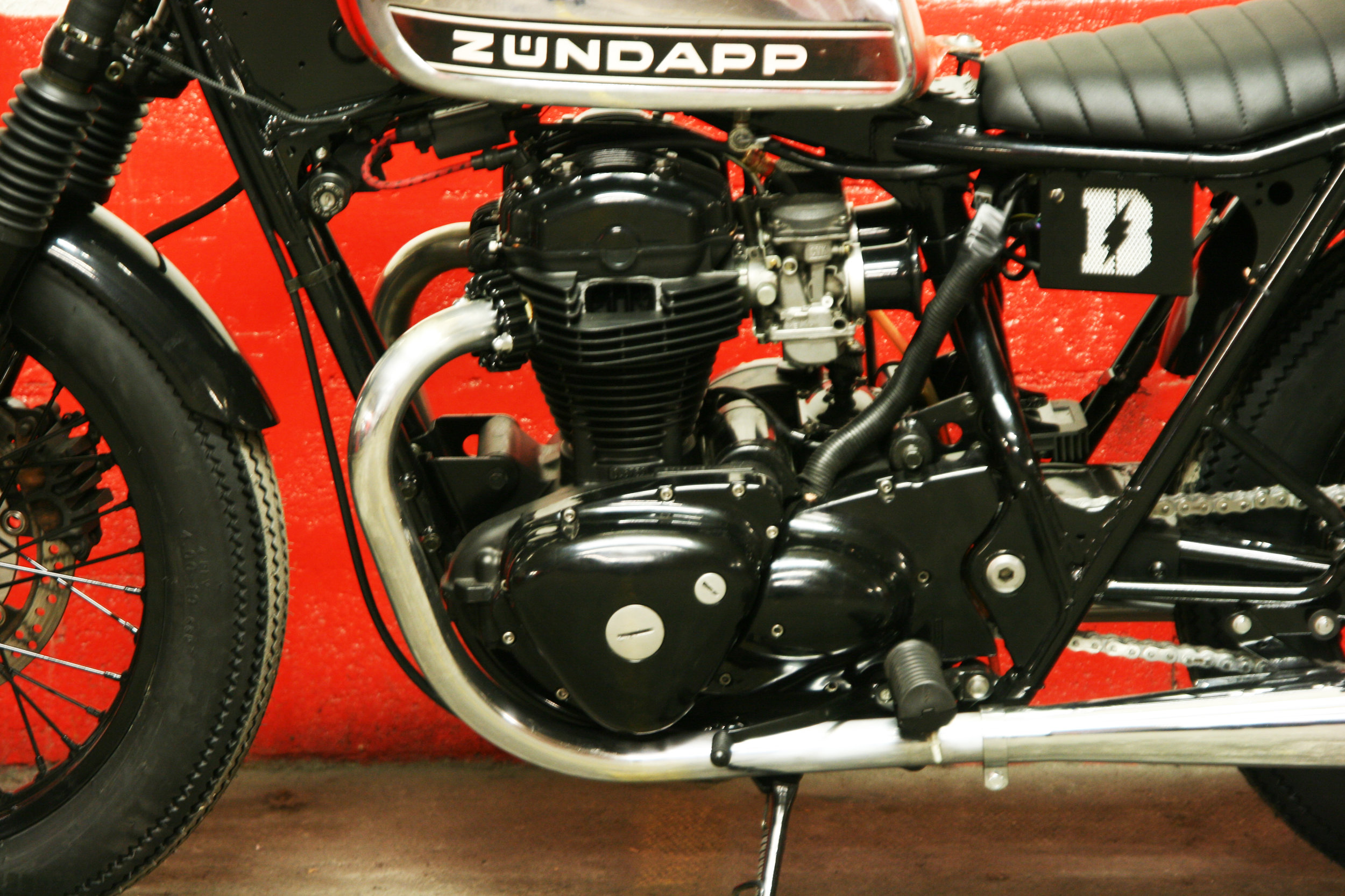 - alloy air filters installed on the re-jetted carburetors;  - fully shiny black powder coated painting of the frame + engine covers + wheels + fork legs + foot pegs + mudguards + handlebar;  - brand new chain + sprocket kit.