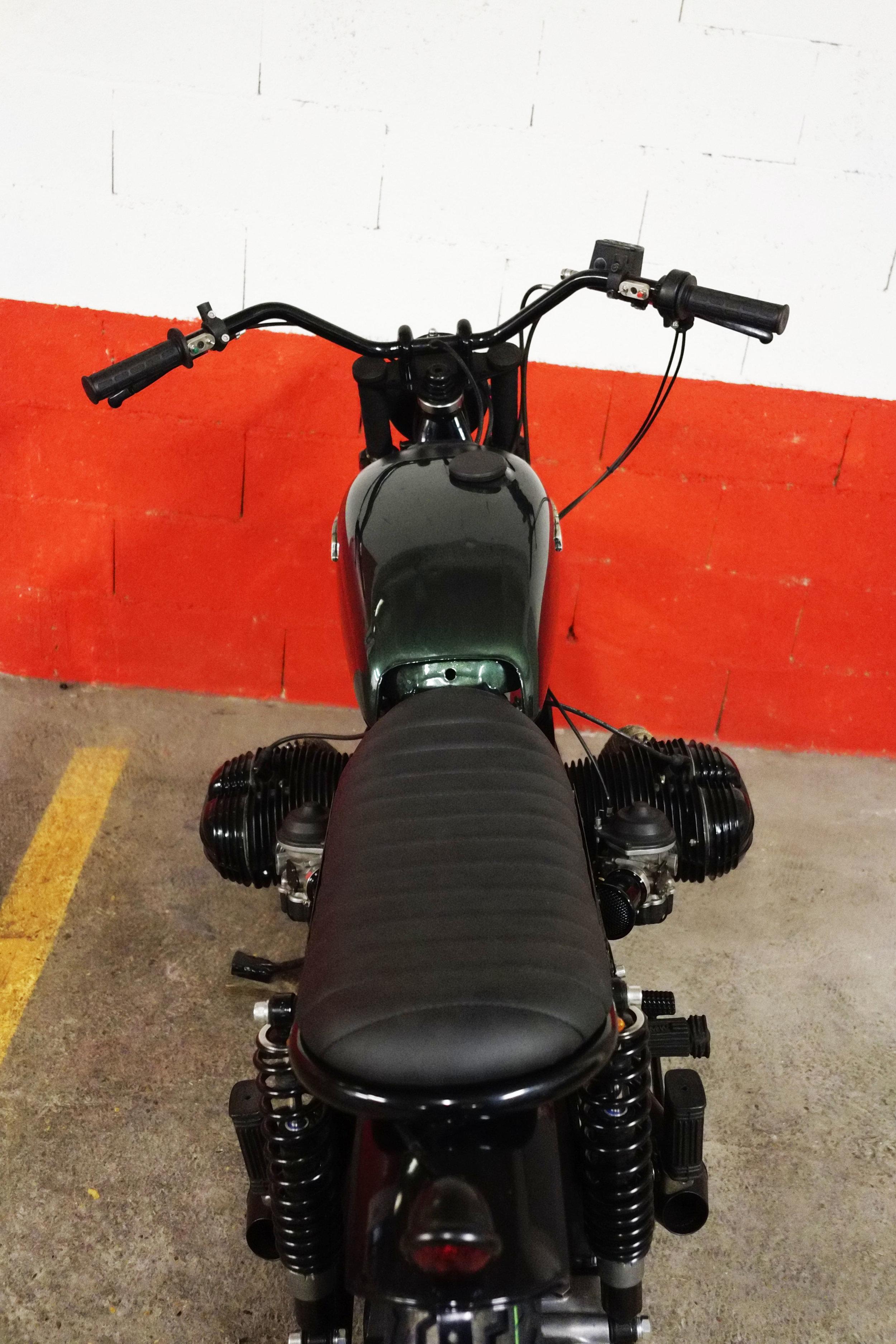 - bespoke rear loop;  - bespoke seat designed to match with the bespoke rear loop;  -  Bates  tail light.
