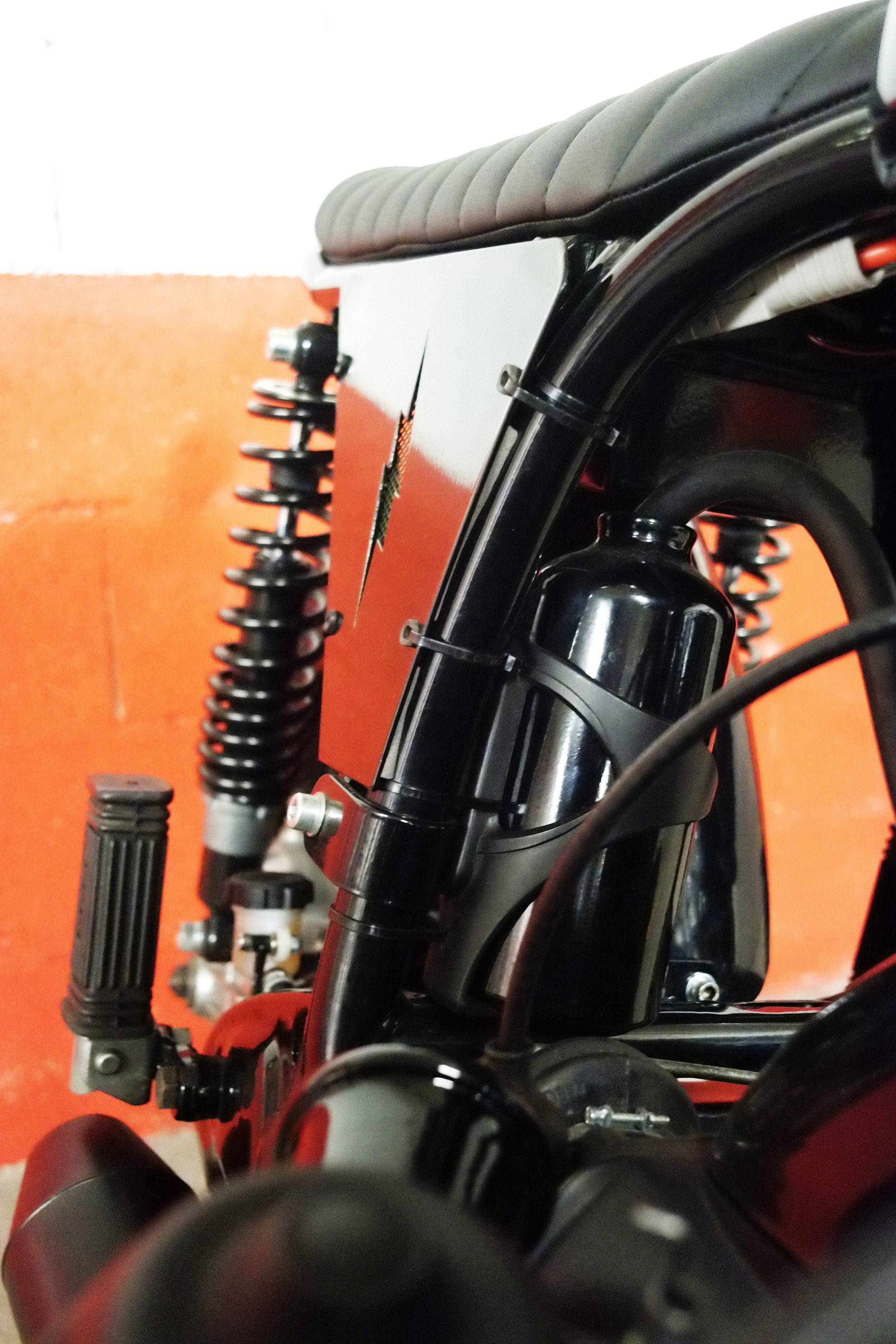 - bespoke engine breather;  -  Blitz Motorcycles  battery covers (laser cut) to match with the bespoke rear loop.