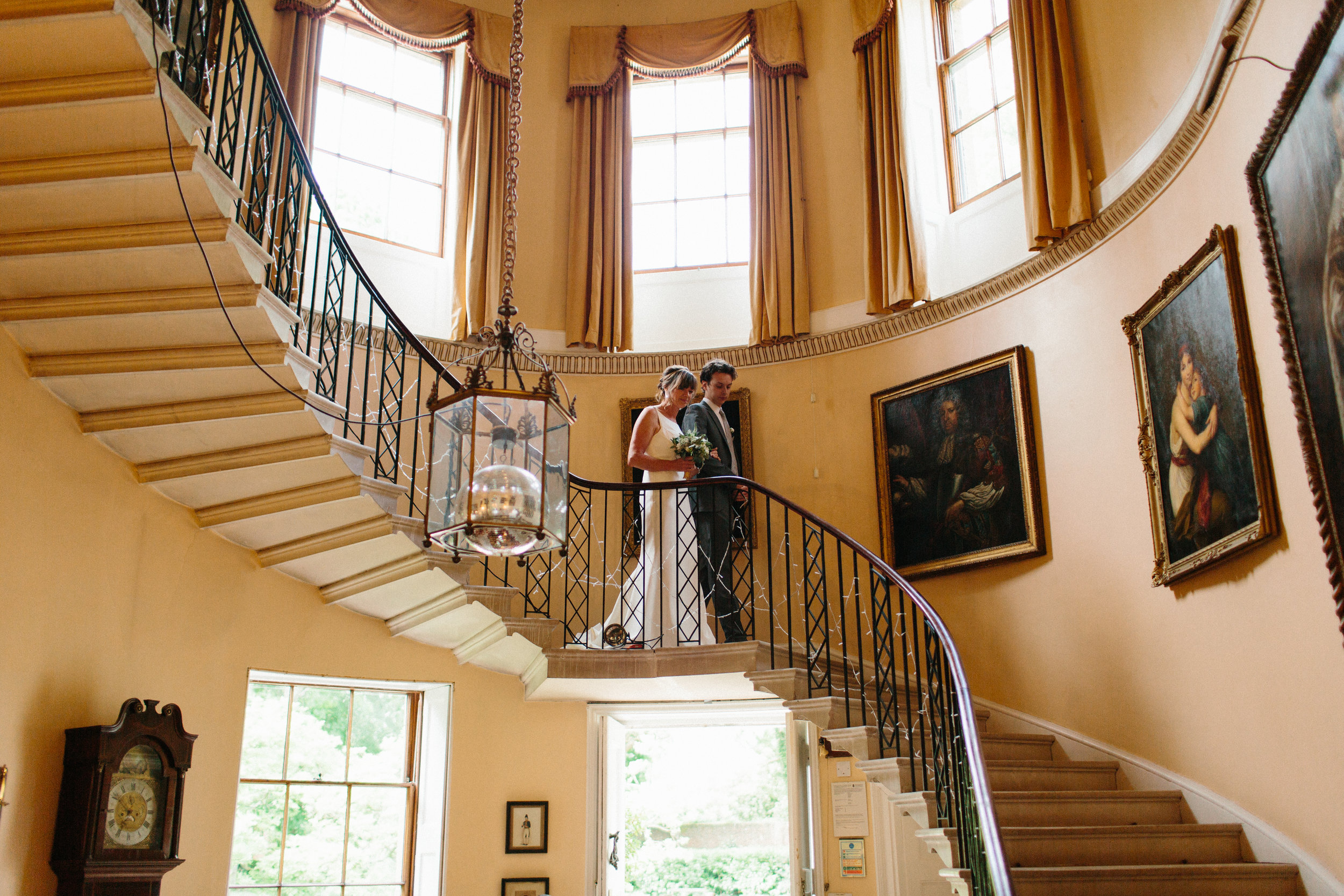 bride sweeping staircase