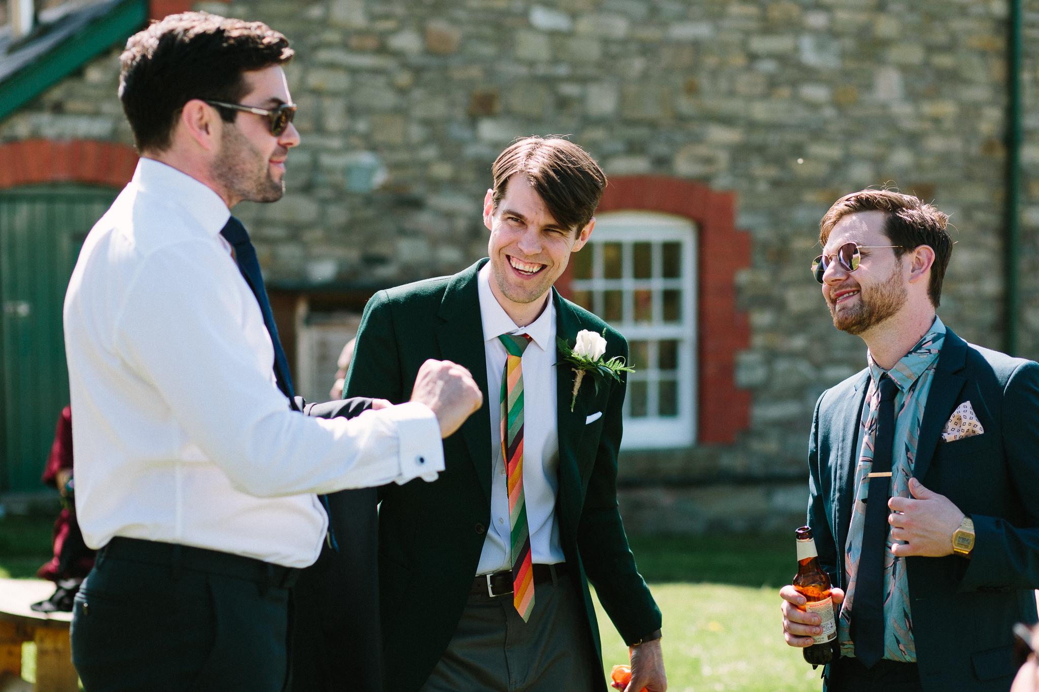 groom prep outdoor wedding
