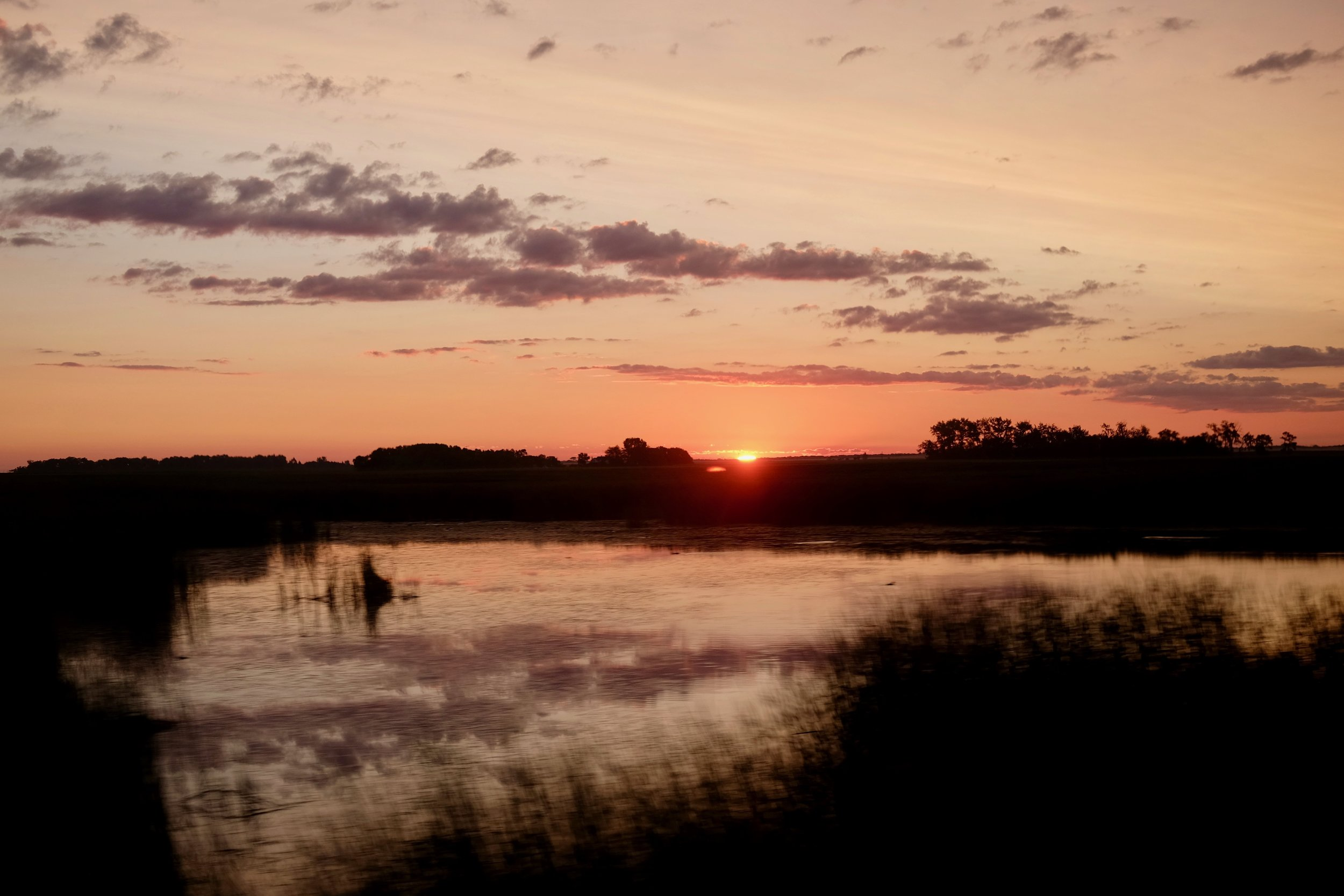 The sun rising near Devil's Lake, North Dakota.