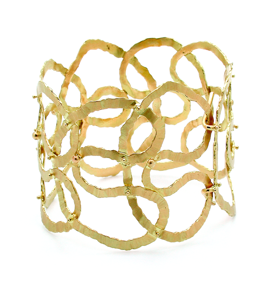 "Gurmit's ""Orgie Of Infinite"" bracelet inspired by the yoni symbol in 18 carat gold."