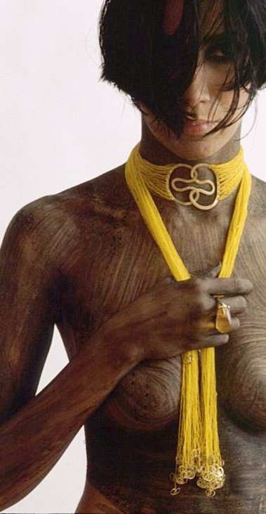 "Gurmit's ""Concubine"" necklace inspired by the yoni symbol. 18 carat gold and glass beads."