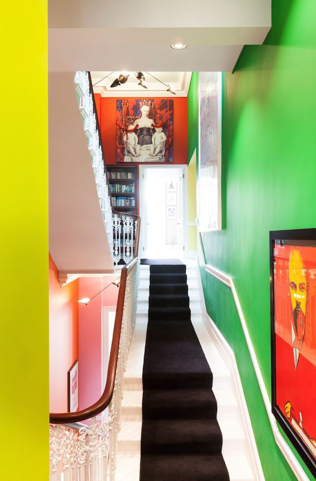 The stairwell in vivid Holy Indian colours.