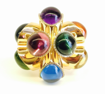 Top view of Gurmit's Puzzel Ring in Rose Gold, diamonds, Amethyst, Mandarin Garnet, Tourmaline, Berl, Swiss Topaz, Peridot, Rubelite and London Topaz.  www.gurmit.com