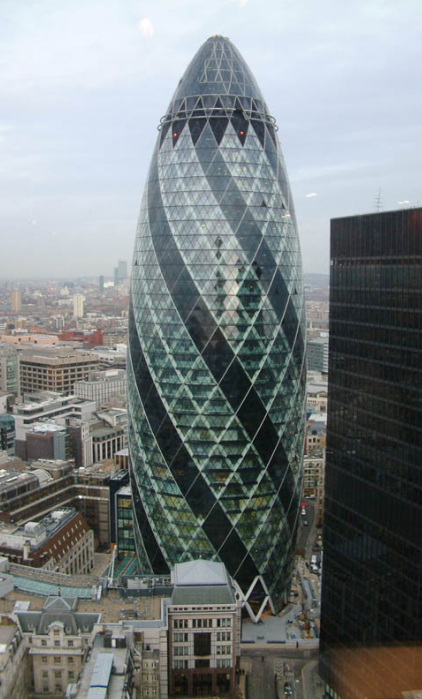 30 St Mary Axe is a tall office building in London known affectionately as The Gherkin. The Gherkin was designed by Sir Norman Foster and opened in 2004. The Gherkin is 180m tall.