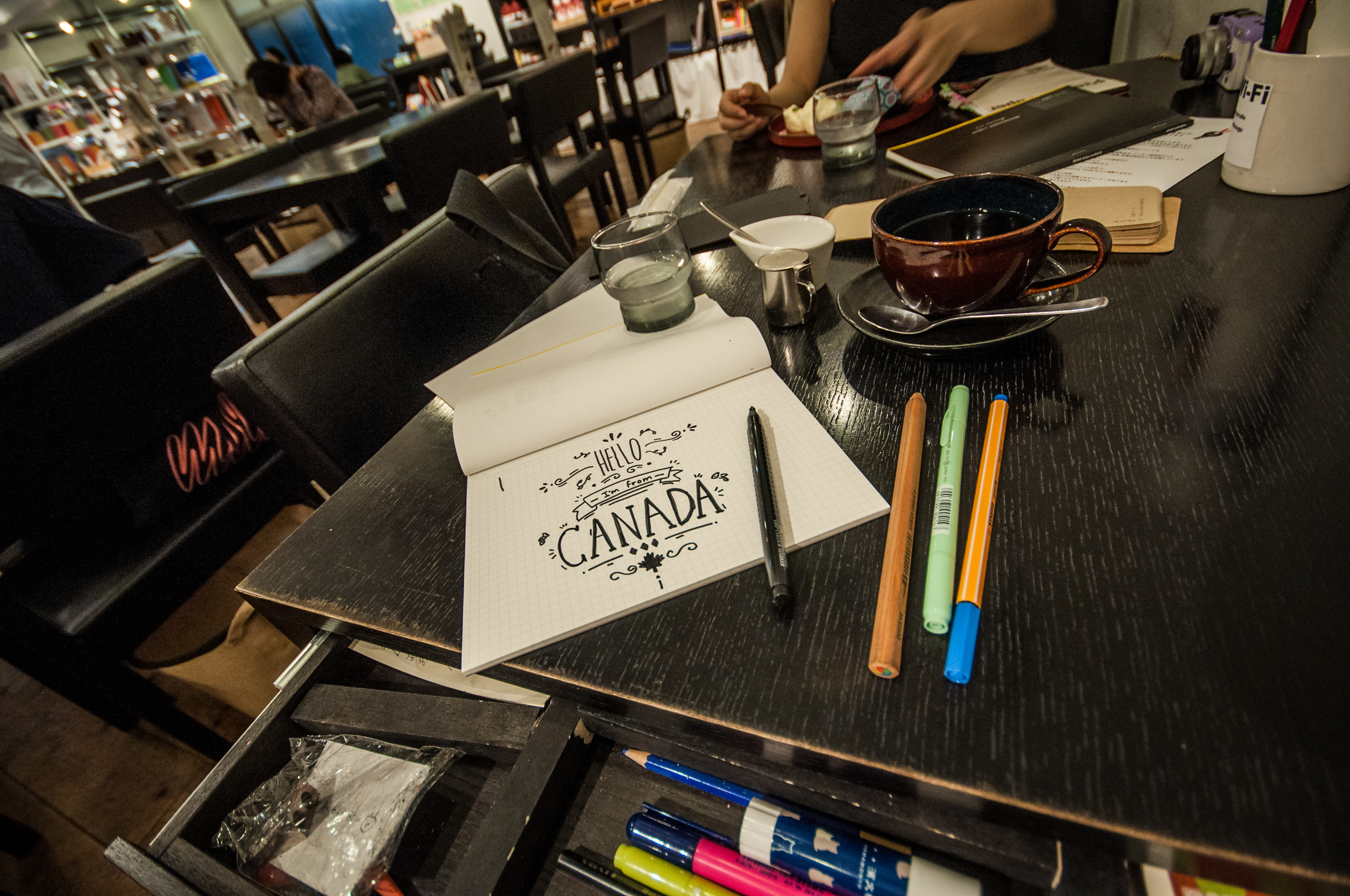 """Doodling while having some coffee. It says, """"Hello, I'm from Canada."""""""