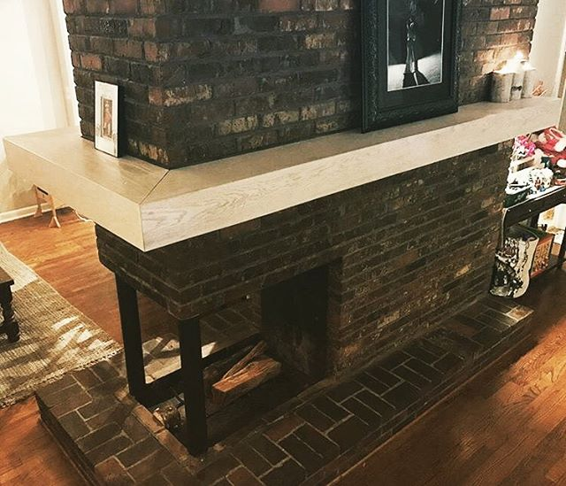 "Second mantlepiece installation in three days. This one is a monster! 6"" thick x 10"" wide. Nearly 18' of whitewashed oak wrapping around three walls, floating off the brick without brackets. Thanks to @mattjnoonan for the photo and the challenging project!"