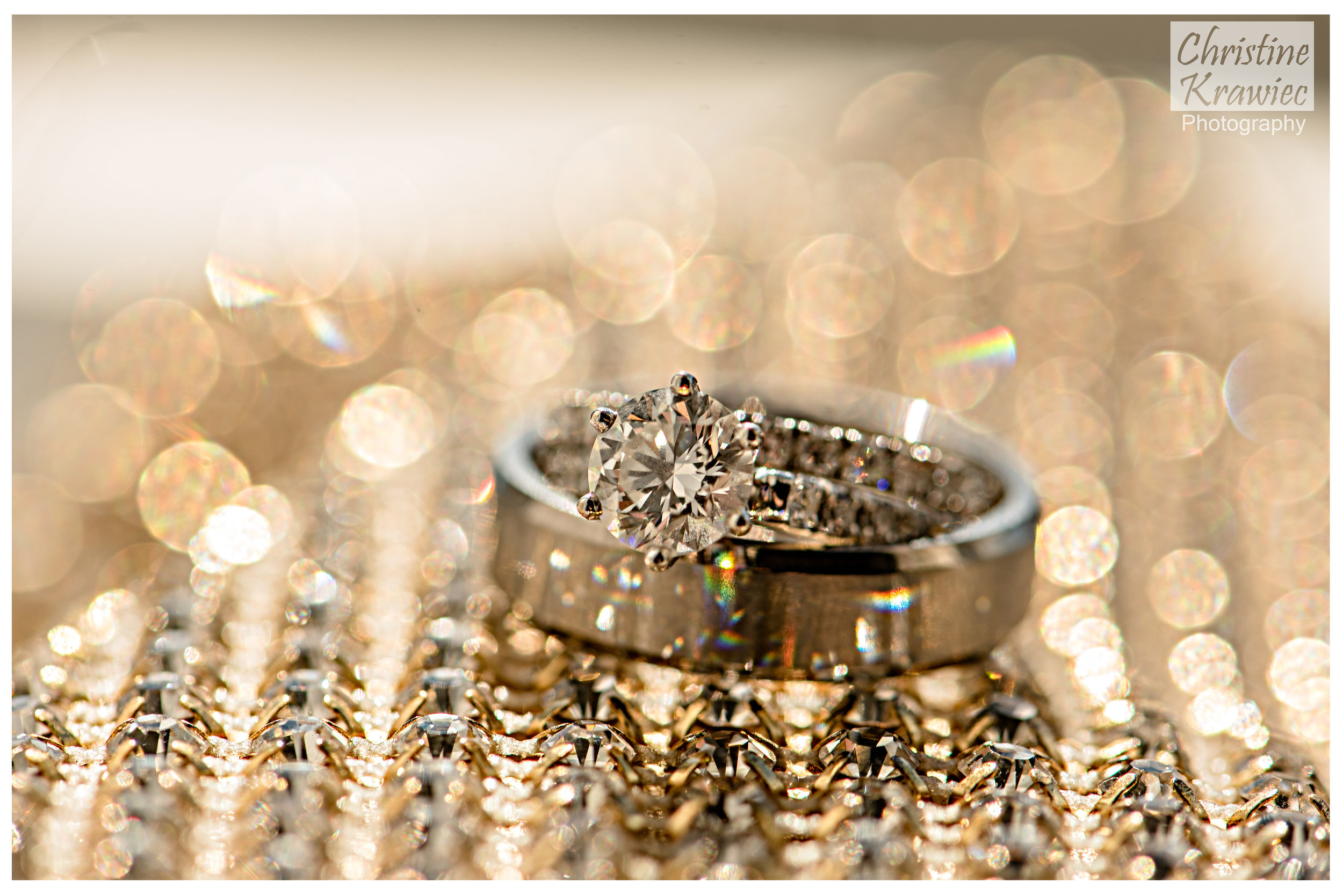 The wedding rings glistened against the backdrop of the bride's gold handbag