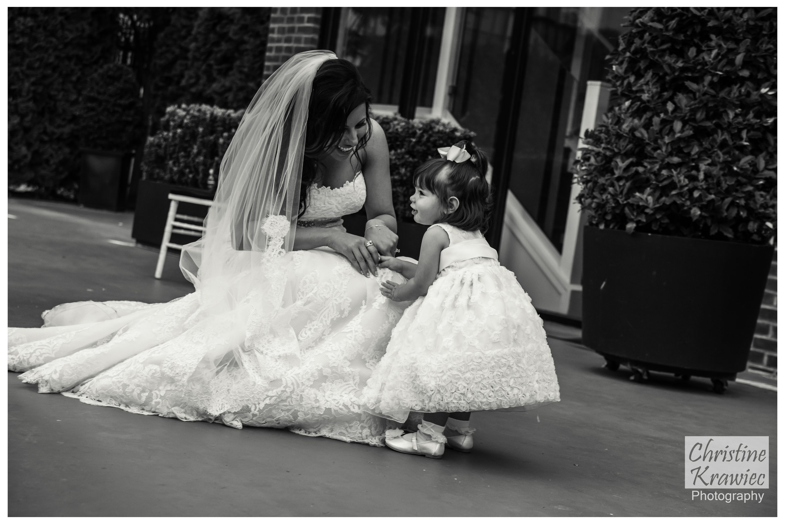 Lauren sharing a quiet moment with her flower girl