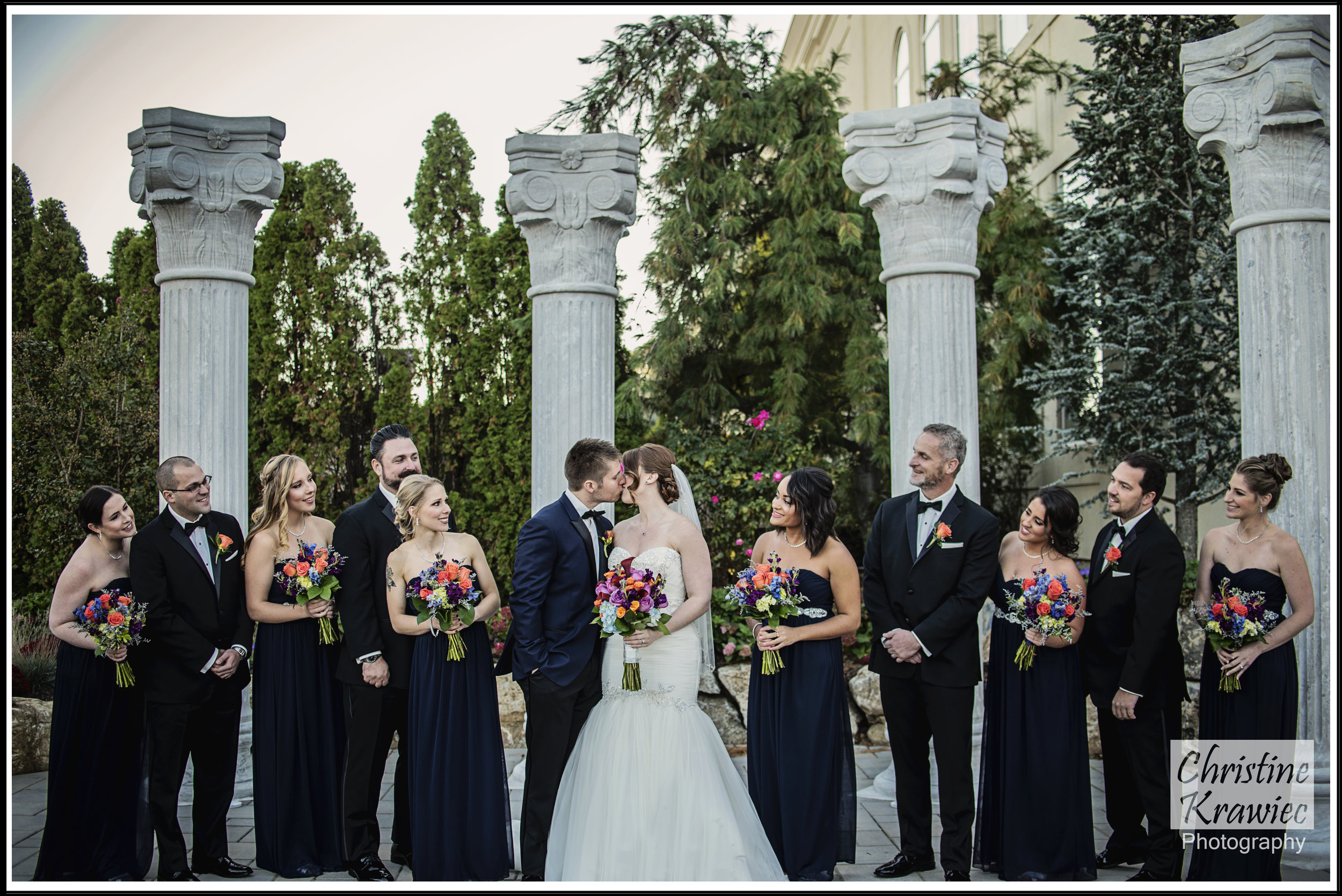 The blues and blacks flow so nicely together in their bridal party, especially Mark's tux!