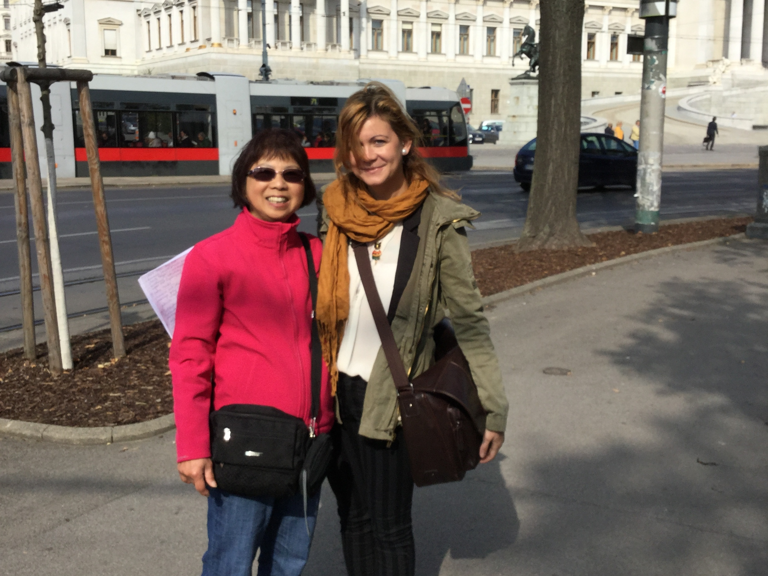 A Vienna Greeter and her guest in front of the Austrian parliament