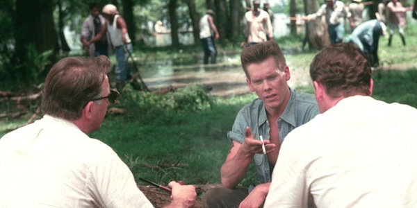 Kevin Bacon talks to Kevin Costner and Jay O. Sanders in Oliver Stone's     JFK