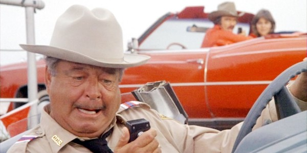 Jackie Gleason (with Burt Reynolds and Sally Field in the background) in Hal Needman's  Smokey and the Bandit