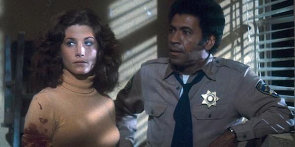 Laurie Zimmer and Austin Stoker in John Carpenter's  Assault on Precinct 13