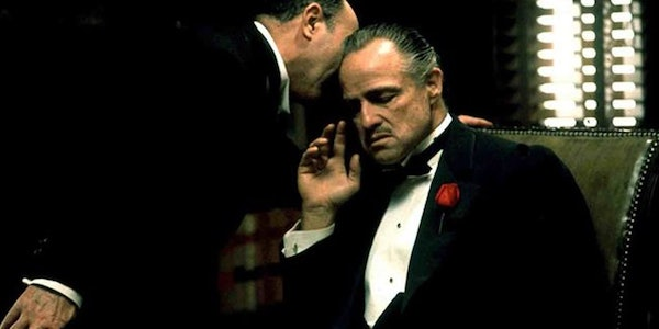 Robert Duvall whispers to Marlon Brando in Francis Ford Coppola's  The Godfather
