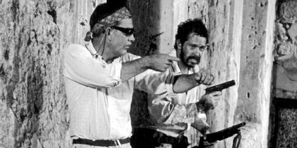 Sam Peckinpah gives Warren Oates some direction on the set of  The Wild Bunch