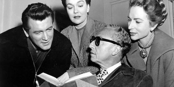 Douglas Sirk (center, in shades) on the set of  All That Heaven Allows  with Rock Hudson, Jane Wyman, and Agnes Moorhead