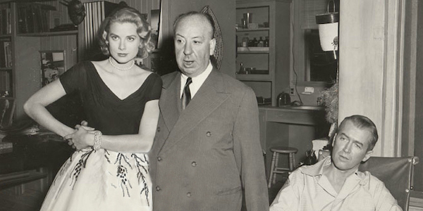 Alfred Hitchcock (center) with Grace Kelly (left) and James Stewart (right) on the  Rear Window  set