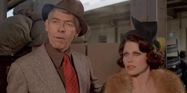 James Coburn and Margaret Blye in Walter Hill's  Hard Times