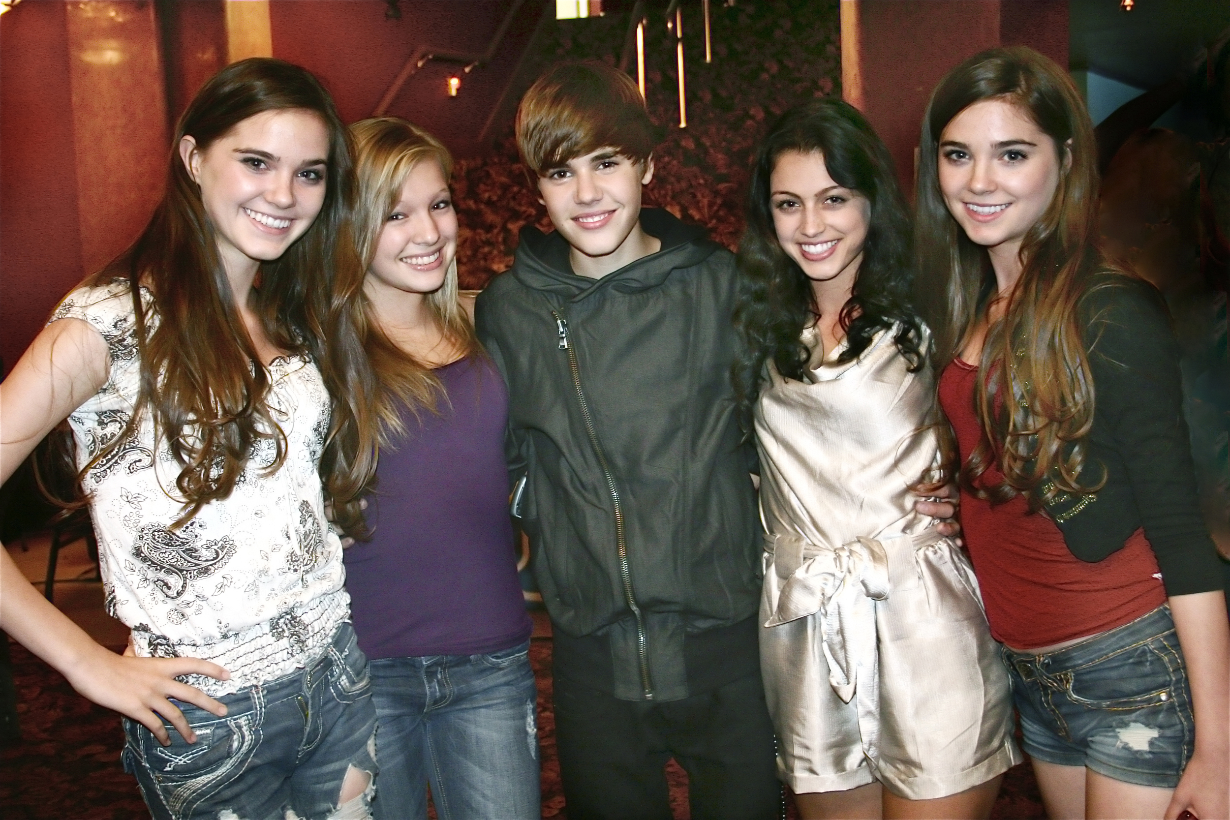 "Nina, far left, Randa, far right, Justin Bieber in the middle. The girls are featured in Justin's ""U Smile"" video."